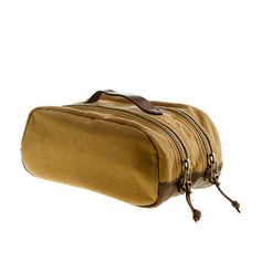 The Coolest Gifts for Men | Men's Health J. Crew Dopp Kit  Any outdoorsman on-the-go needs a place to put all his stuff—and this hunting-inspired travel kit from J. Crew is just the gift for him. The waxed cotton canvas and leather exterior ensure durability, whether you're hiking through the outback, hunkering down in an Appalachian cabin, or enduring the most unforgiving terrain of all: the bag check at JFK. $58
