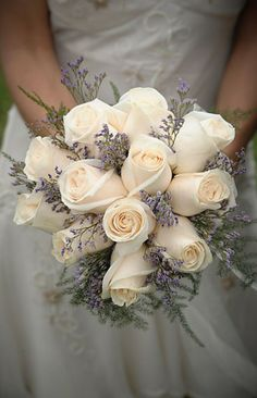 I LOVE LOVE LOVE this bridal boquet! I picked white roses. I'm going to call and see if they can add the lavender to match Christina Tisdale... #weddings