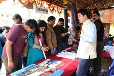 China's stall at Surajkund International Crafts Mela offers handy information about the tourist destinations of the country! International Craft, Stalls, Destinations, Country, Crafts, Manualidades, Rural Area, Country Music, Handmade Crafts