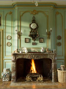 This is an absolutely stunning fireplace, especially with the use of light greens and golds. Love the old world charm of this space without it feel overly heavy and old/dated French Country House, French Farmhouse, French Country Decorating, French Home Decor, Georgian Interiors, French Interiors, Interior Decorating, Interior Design, French Chateau