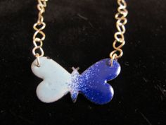 Silver and enamel butterfly necklace pendant in by Naomirabinowitz, $20.00