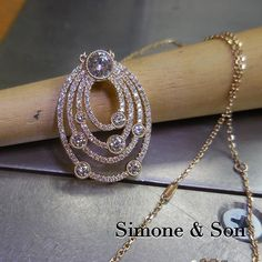 Take a look at this custom diamond pendant we just finished up! The number of diamonds in each row has significance to the couple and the piece symbolizes their universe. Beautiful! #custompendant #anaversary #diamond #jewelrydesign #timelessbeauty #custommade #simoneandson