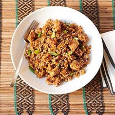 Brightly flavored with garlic, ginger, soy sauce, and rice vinegar, this pork fried rice recipe is faster than take-out—ready in just 15 minutes.