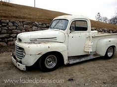 that's my stella...a white '49 ford truck...she's a vintage beauty...faded charm...