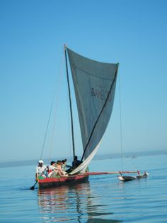 Students riding in a traditionally crafted fishing boat off the coast of Ifaty, on Madagascar's west coast.