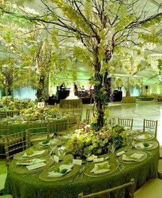 Don't look at table cloths or settings- this is just starting inspiration for tree centerpieces. Colors can coordinate back to event colors. Could be beautiful!