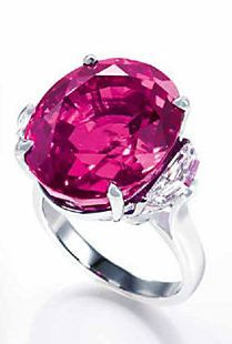 A SUPERB PINK SAPPHIRE AND DIAMOND RING