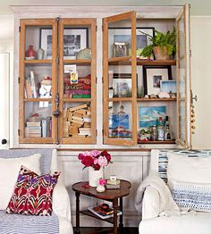Glass front cabinets double as storage and display! More display ideas: http://www.bhg.com/decorating/small-spaces/homes/small-house-budget-decorating/?socsrc=bhgpin011114collectorscabinet&page=4