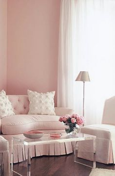 This sweet, pale pink room seems like the perfect place to relax.