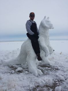 A Man Builds a Snowman That Looks Like a Tauntaun From 'Star Wars' and Sits on Its Back