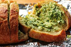 Artichoke Feta Garlic Bread - Saw a spam poster link to this image on a fake blog, but I had to find the real thing.  This looks so yummy.