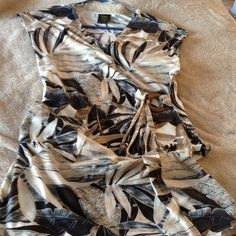 Classy Beach Cover-Up Neutral tans and browns with cream in a tropical leaf pattern make up this modest beach cover up.  Side ties close. Jackets & Coats