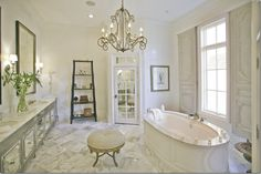 so elegant ~ love the chandelier & the mirrored water closet door ~ Memphis, TN, master bath of designer Amy Howard. Via Cote de Texas.