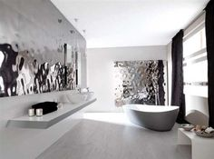Chrome wall tiles, Sea Silver from Porcelanosa