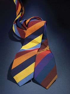 Vividly colored woven multi-stripe ties in a crisp Mogador weave of English silk and cotton. Shown left to right: B-sunshine, cobalt, guardsman, copper, navy; C-violet, fire, regal, wine, beech.