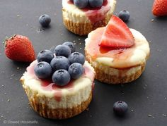Mini Cheesecakes | Unwed Housewife | Quick 'n easy mini cheesecakes with graham cracker crusts. Topped with blueberry and/or strawberry jelly. An easy dessert recipe that's perfect for 4th of July.