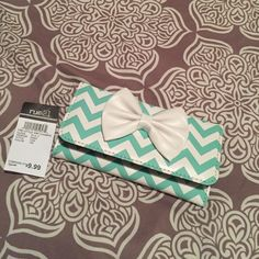 RUE 21 wallet Very cute turquoise and white chevron pattern wallet. 6 card holder slots, coin purse and extra storage Bags Wallets