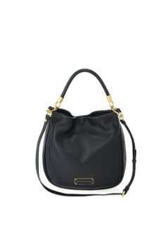 A key accessory for the Marc by Marc Jacobs collection, the Too Hot to Handle Hobo is a spacious every-day bag that completes a professional yet casual look. The Hobo bag features our modernized logo plaque detailing, magnetic closure, and a detachable cross-body strap for an alternate carrying option.