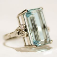 Ladies Art Deco 14K white gold ring with large 13.5ct. natural emerald cut aquamarine and diamonds in unique setting.