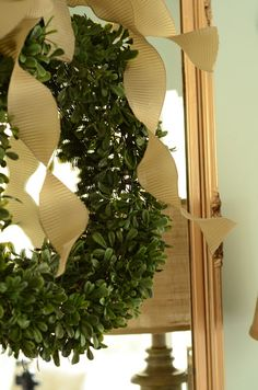 Christmas details.....boxwood wreath with lovely bow hung on mirror