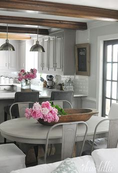 Using unique items like a dough bowl on the table or a lantern on the counter (like this one from @homegoods) is a fun and unexpected way to display fresh cut flowers like these pink peonies. (sponsored pin)