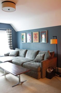 bedroom wall color... and I think those are t-shirts in frames