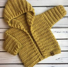 Rose black rose stitches on this painted canyon cardigan just screams fall! golden yellow is perfect for boys and girls i imagine it being worn for fall photos with a baby kimono free pattern Crochet Baby Sweater Pattern, Crochet Baby Sweaters, Baby Sweater Patterns, Knitted Baby Clothes, Crochet Coat, Baby Girl Crochet, Crochet For Boys, Newborn Crochet, Baby Knitting Patterns