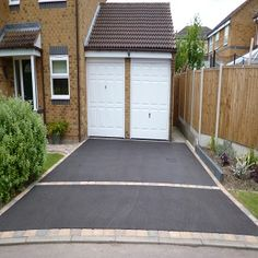 Tarmac as it is sometimes known is laid for surfacing roads, automobile parks and driveways. It is seen as a practical, comparatively low cost surface but as with any other outside product, over ti… Driveway Border, Driveway Paving, Driveway Design, Driveway Entrance, Driveway Landscaping, Concrete Driveways, Backyard Fences, Driveway Ideas, Walkways