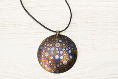 Unique large round multicolored titanium pendant from Arpelc Blue Titanium Jewelry by DaWanda.com