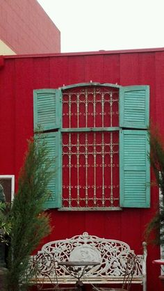 Who needs a window? Exterior shutters & iron work, amazing!