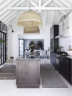 The Guest House at Hibiscus Hill | Design by India Hicks. Stunningdining room designed by Alanna Smit Designsandphotographed bySimon Whitbread. The beautiful vintage window frame turned mirror is from Manyara Home, topped off withwhite, rattan,palm leaves and a giant clamshell – just beautiful! Tropical bathroom via Fanimation. The rattan fan …