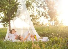 Sisters. I have a sheer tent like this. Time-wise, this was taken at sunset. tulipdesigns