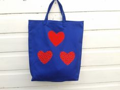 Blue tote bag with red hearts appliquéd onto the front. French seams have been used to finish the inside seams of this unlined bag. French Seam, Hearts, Reusable Tote Bags, Red, Inspiration, Biblical Inspiration, Heart, Inspirational, Inhalation
