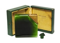 1930 Baccarat, Myon Coeur de Femme perfume bottle, cased green crystal, green crystal stopper, hinged gilt metal cover, box (lacking strap closure). 3 in.