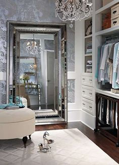 That wall treatment, too! >>>Walk in closet with a gigantic mirror & a gorgeous Chandelier, glam up my closet please!!
