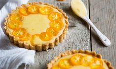 Smooth lime curd filling sits in a perfectly flaky dough shell and is topped with sweet-tarte kumquat slices. My Recipes, Dessert Recipes, Favorite Recipes, Mini Tartlets, Lemon Curd, Something Sweet, Recipe Collection, A Food, Delicious Desserts