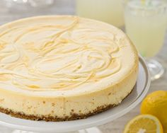 This easy baked lemon cheesecake with a lemon curd swirl makes a great make ahead dessert for a dinner party