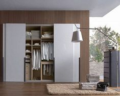 Top 12 Minimalist Wardrobe Designs For Small Space : Elegant White BuiltIn Wardrobe Design with Sliding Door and More Storages for Small Spa...