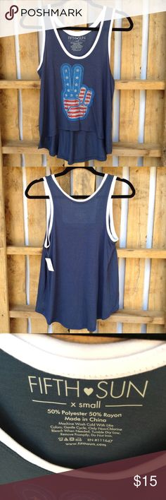 "Fifth Sun hi lo tank top with patriotic hand This is a navy blue loose fitting tank top APPROX FLAT MEASUREMENTS  23""-29"" ↕️ 17"" ↔️ Armpits BH3 Fifth Sun Tops Tank Tops"
