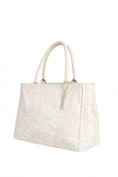 Just bought it and can't wait to use it! Oscar de la Renta Tote for The Neiman Marcus X Target Holiday Collection