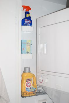 Hold laundry clutter in wall mounted baskets to the side of the machines. Love this since I am so short it is hard to reach shelves mounted behind the washer and dryer!