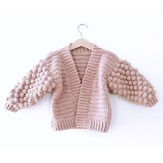 Ravelry: Mini Poet Cardigan pattern by Little Golden Nook Knitted Baby Clothes, Crochet Clothes, Baby Knits, Christmas Knitting Patterns, Baby Knitting Patterns, Jumper Patterns, Crochet Cardigan Pattern, Dress Gloves, Yarn Brands