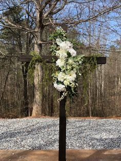 Beautiful Cross for your Ceremony!    Floral not included.  This picture is showing silk flowers used for decor.