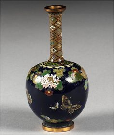 A cloisonné vase, Meiji Period, signed Namikawa Yasuyuki, decorated with a kacho-ga of butterflies and flowers, the base with white-metal plaque