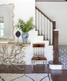 Fabulous foyer features a gold faux bois console table under a scalloped mirror next to a French chair upholstered in tiger print fabric alongside a Beni Ourain rug. Design Entrée, Design Blog, Home Design, Design Ideas, Interior Design New York, Decor Interior Design, Foyer Decorating, Decorating On A Budget, Entry Way Design