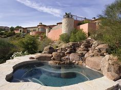 saltwater pool framed by boulders | #OrganicSpaMagazine
