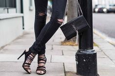 black strappy heels, ripped skinny jeans, black croc YSL tassel bag