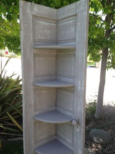 re-purposed door split down the middle and made into a corner shelf painted in Annie Sloan French Linen