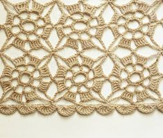 Photo about Beige crochet lace on white background. Image of surface, textured, pattern - 33536972 Photo about Beige crochet lace on white background. Image of surface, textured, pattern - 33536972 Crochet Skirt Pattern, Crochet Blouse, Crochet Squares, Crochet Motif, Crochet Shawl, Crochet Doilies, Crochet Flowers, Crochet Stitches, Crocheted Lace