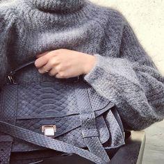 Grey mohair sweater + Proenza Schouler bag.